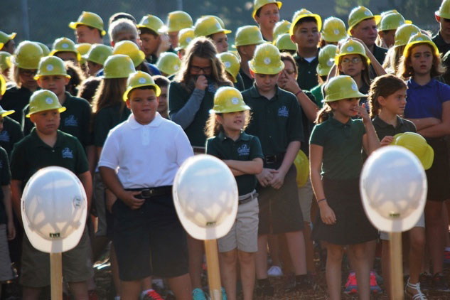 Central Lutheran students await the groundbreaking in their own hard hats