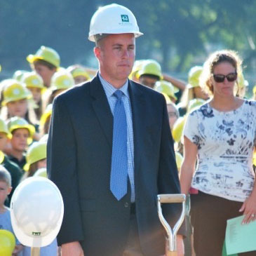 Principal Kevin Creutz awaits the official groundbreaking