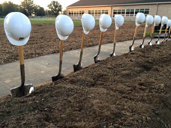 Shovels and hard hats wait to be used